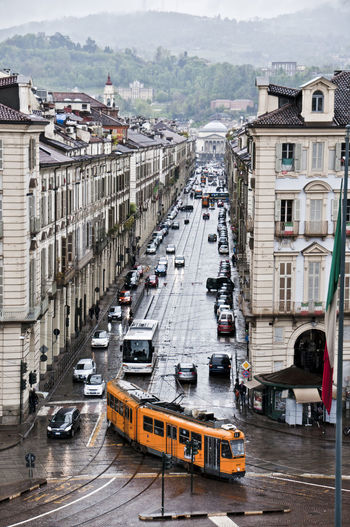 Turin in a rainy day. Via po and on the background GrandMother church. High Angle View Mode Of Transport Transportation Day Outdoors ArchitectureGviarizzo Turin Italy Eyemgallery City Building Exterior No People Nautical Vessel Water Sky Tram Transportation The Street Photographer - 2017 EyeEm Awards The Architect - 2017 EyeEm Awards BYOPaper!