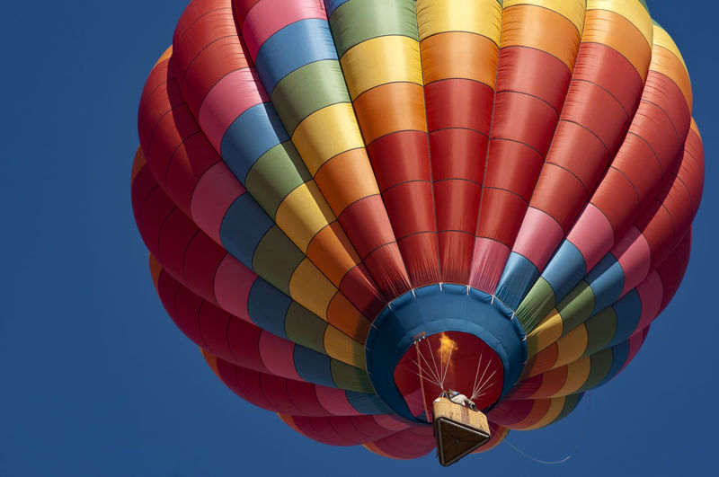 Hot air balloon Balloon Basket Clear Sky Flame Flying Horizontal Composition Hot Air Balloon Looking Up! Low Angle View Multi Colored Outdoors Sky Transportation