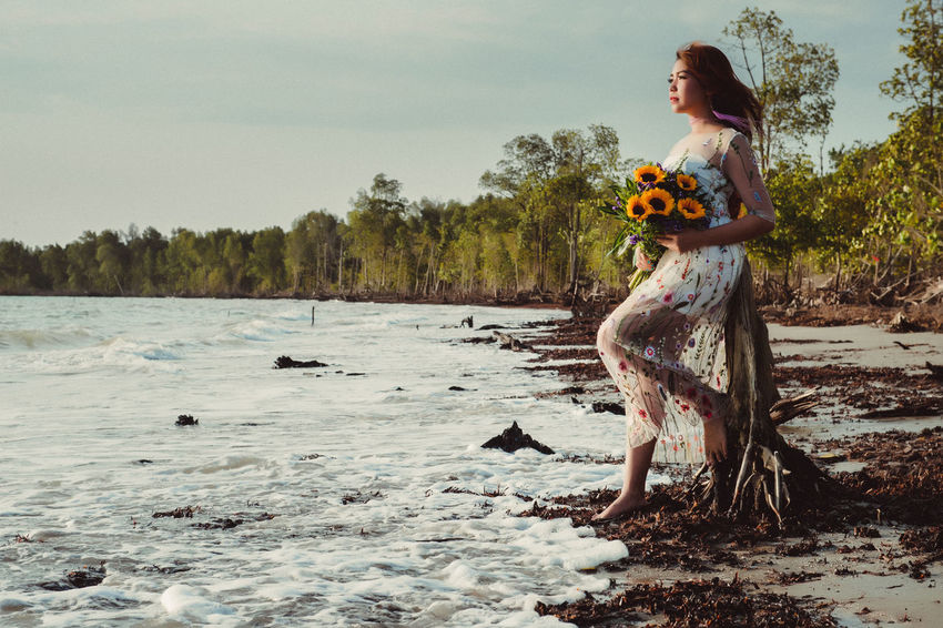 Adult Beautiful Woman Beauty In Nature Day Fashion Flower Full Length Nature One Person One Young Woman Only Outdoors People Real People Sky Standing Tree Water Young Adult Young Women