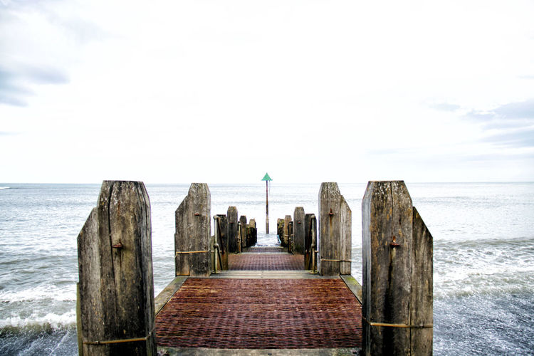View Of Jetty In Sea Against Sky