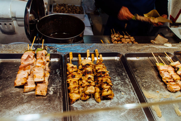 High Angle View Of Yakitori In Tray At Market Stall