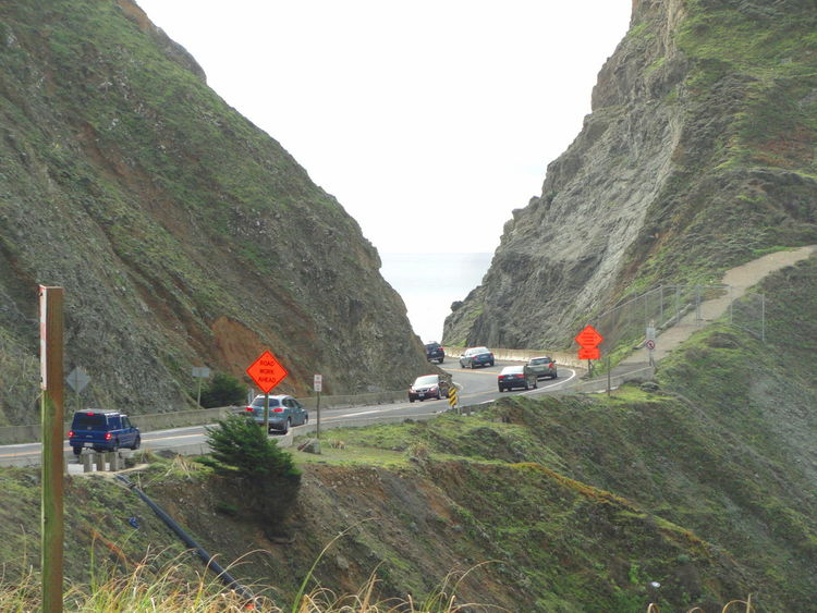 Car City Life Clear Sky Cliff Day Green Color Journey Land Vehicle Mode Of Transport Mountain Mountain Road On The Move Outdoors Road Road Closed Road Work Ahead Stationary Street Highway 1 Traffic Transportation Travel Valley Vehicle Cliffs