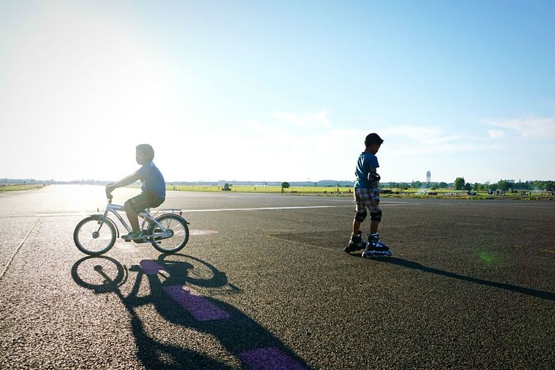 Boys Cycling On The Move Bicycle Side View Freedom Silhouette Street Photograpy Street Berlin Tempelhofer Feld (Tempelhof Field) People And Places