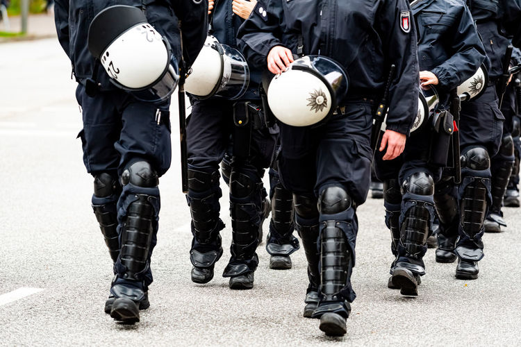 Low section of police force walking on street