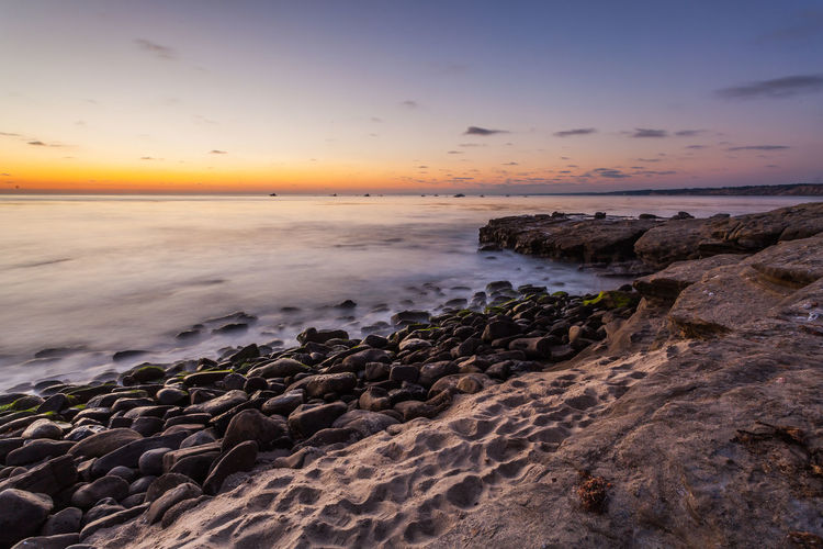 La Jolla Cove at Sunset San Diego Beach Beauty In Nature Cloud - Sky Horizon Horizon Over Water Idyllic La Jolla La Jolla Cove Land Nature No People Orange Color Outdoors Rock Rock - Object Rocky Coastline Scenics - Nature Sea Sky Solid Sunset Tranquil Scene Tranquility Water