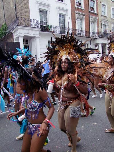 Nottinghill Carnival 2013 Carnival Composition Costume Cultures Dancer Dancing Enjoyment Feathers Festival Front View Full Frame Full Length Fun GB Happiness Incidental People Leisure Activity Lifestyles London Multi Coloured Nottinghill Carnival Outdoor Photography Tourist Attraction  Uk Young Woman