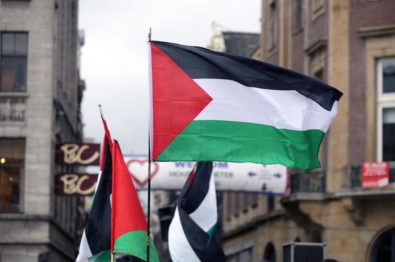 Flag against buildings in city