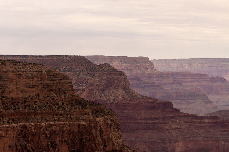 Beautiful view of the Grand Canyon from the south rim EyeEmNewHere Copy Space Grand Canyon Beauty In Nature Canyon Climate Cloud - Sky Environment Eroded Formation Geology Nature No People Outdoors Physical Geography Rock Rock - Object Rock Formation Scenics - Nature Sky Solid Tranquil Scene Tranquility Travel Travel Destinations Wallpaper