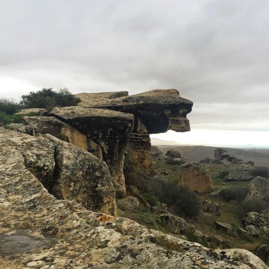 Rock - Object Rock Formation Nature Geology Sky Beauty In Nature Tranquil Scene Cloud - Sky Scenics Outdoors Landscape Day Physical Geography No People Horizon Over Water