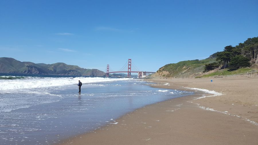 Sky One Person Clear Sky Outdoors Day Water Sand One Man Only Bridge - Man Made Structure People Only Men Nature Adults Only Beach Adult Adventure Cityscape Nature Vacations Golden Gate Bridge Ocean View Bridges_aroundtheworld Bay Area City Life Real People