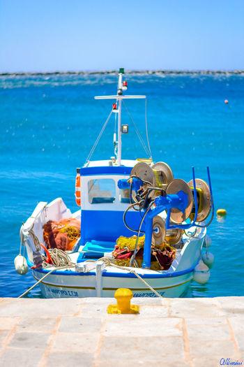 Ship Moored On Beach Against Clear Blue Sky