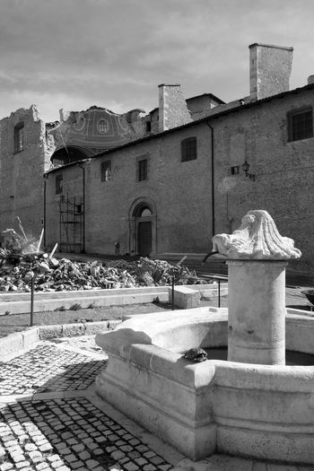 Square with fountain and church destroyed by the earthquake Abruzzo Church Fountain L'Aquila Rubble Wall Ruins Architecture Black And White Blackandwhite Building Exterior Built Structure City Destroyed Destroyed Building Earthquake Earthquake In Italy Eartquake L'aquila Italy No People Outdoors Sky