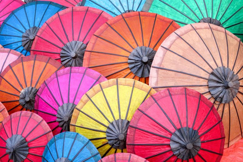 Full frame shot of multi colored umbrellas at market