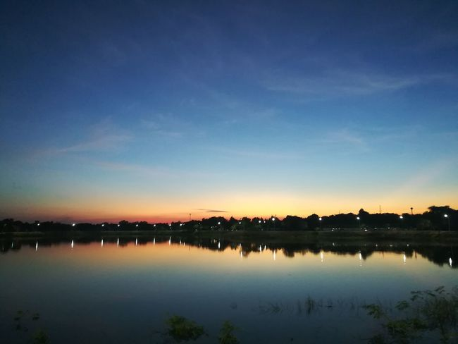 Running Reflection Sky Water Sunset Night No People Lake Outdoors Scenics Blue Illuminated Beauty In Nature City Nature Horizon Over Water Everning Everning Sky Sunset_collection