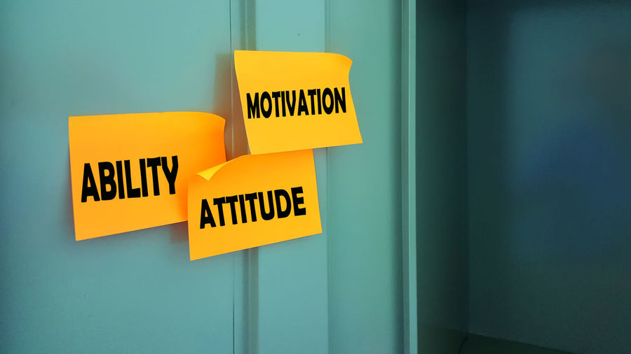 Motivation words on gym locker room. Give Up Motivation Ability Attitude Capital Letter Close-up Communication Day Green Color Guidance Gym Indoors  Message Never No People Text Yellow