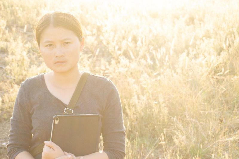 on the meadow. Meadow One Person Plant Young Adult Nature Sunlight Portrait Adult Field Land Grass Front View Holding Technology Lifestyles Day Outdoors Lens Flare