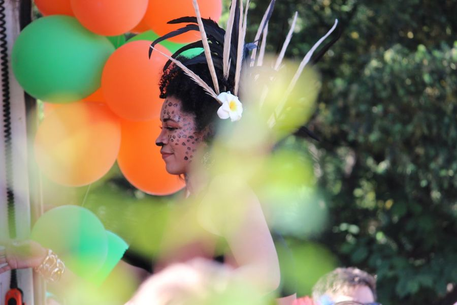 Lady Bird Feathers On Head Carnival Procession Close-up Coloured Baloons Fragility Outdoors Painted Face Plant Selective Focus Soft Focus