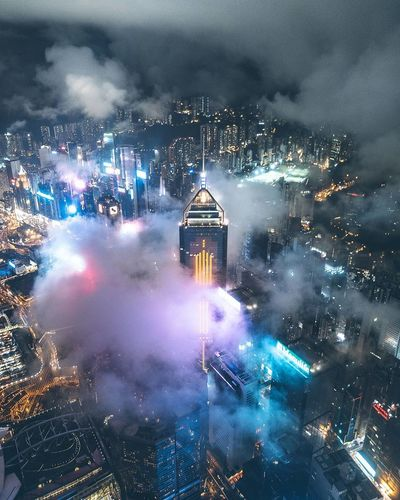 Arts Culture And Entertainment Cloud - Sky Sky No People Night Outdoors Aerial View Travel Destinations Illuminated Cityscape Skyscraper Nightlife Blue Water City Urban Skyline Space Galaxy Built Structure City Life Street Architecture People Men City
