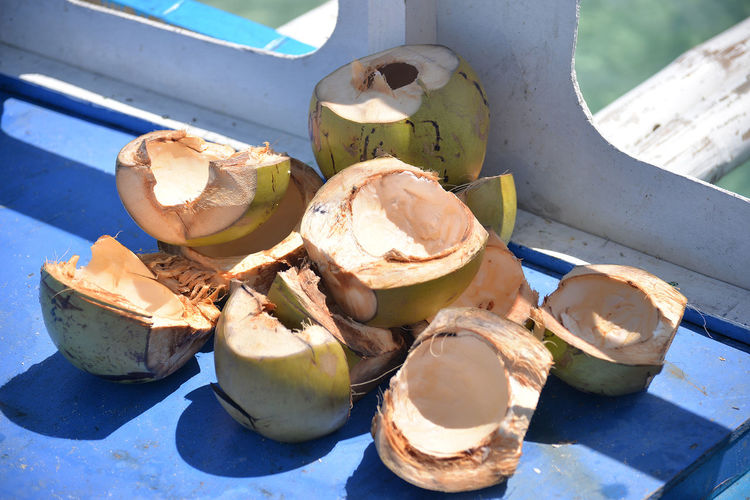 High angle view of coconuts on table
