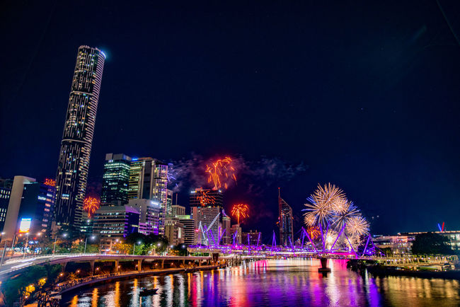 Architecture Bridge - Man Made Structure Brisbane Building Exterior Built Structure City Cityscape Firework - Man Made Object Firework Display Fireworks Illuminated Modern Night No People Outdoors River River Fire River View Riverbank Riverside Sky Skyscraper Travel Destinations Water Waterfront