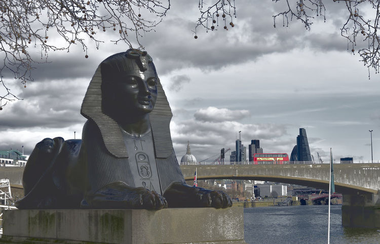 Art And Craft Atmospheric Sky Built Structure City City Life Clouds And Sky Cloudscape Human Representation Landmark London Bus No People Sky Sphinx Statue Tourism