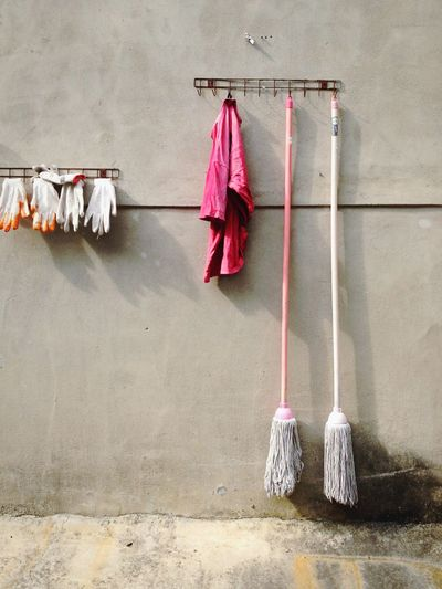 Cleaning equipment hanging on wall
