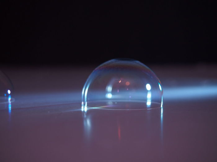 Close-up of bubble on table