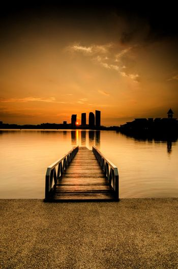 Jetty to Sunrise Putrajaya Malaysia Sunrise Dawn Dusk Sun Sunbeam Jetty Wooden Jetty Long Exposure Building Building Exterior Water Sea Sunset Beach Groyne Horizon Jetty Reflection Pier Sky Seascape Romantic Sky Tide Dramatic Sky Moody Sky Calm Low Tide Coastline