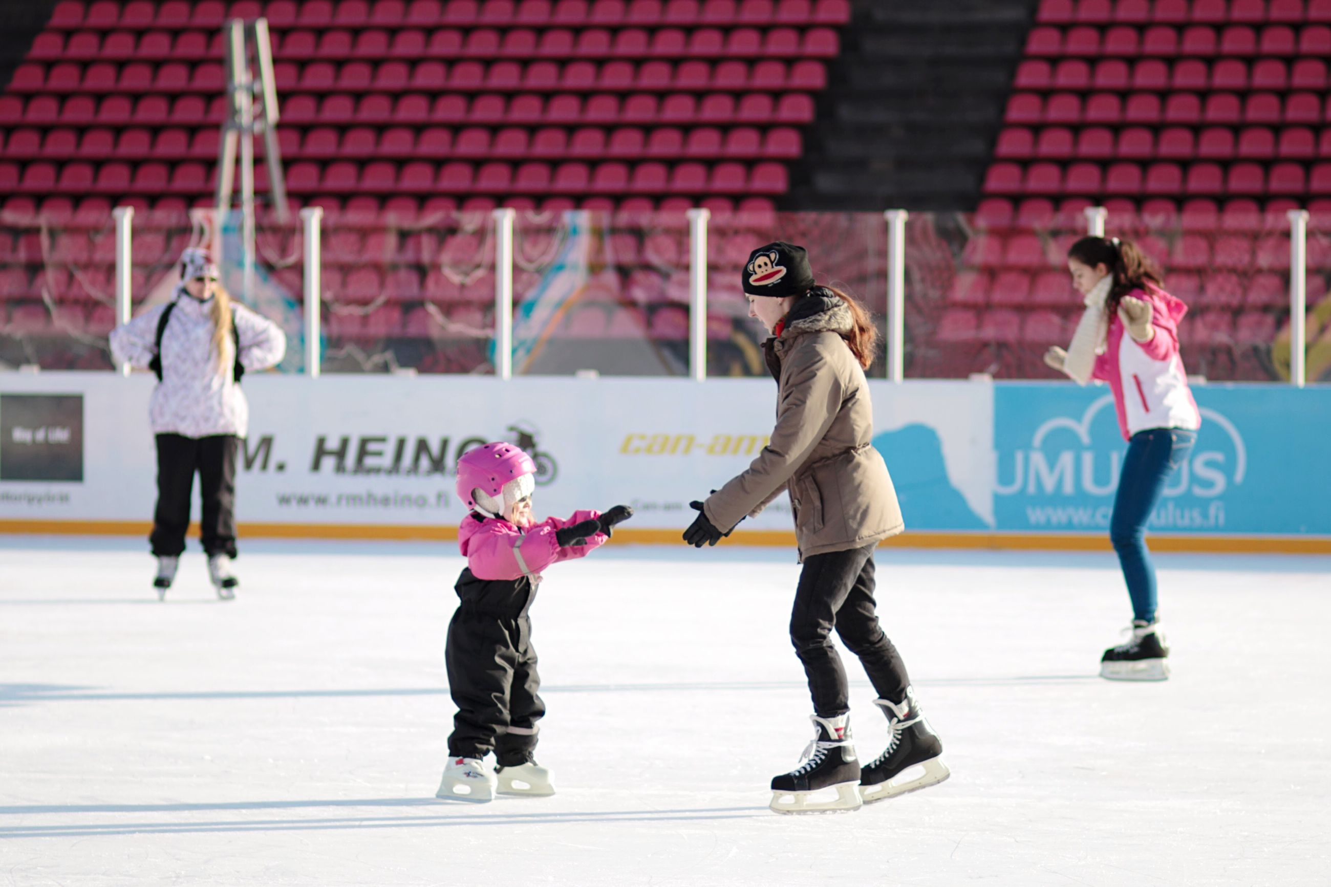 full length, girls, candid, leisure activity, child, outdoors, recreational pursuit, people, day, young adult, adult, friendship, young women, ice rink, taking a shot - sport