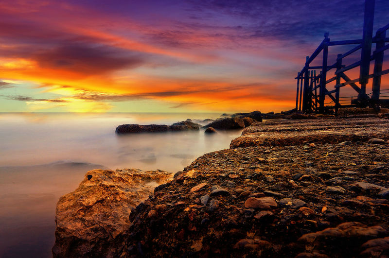 Sunset at Kemala beach Sky Sunset Water Cloud - Sky Scenics - Nature Rock Sea Rock - Object Solid Beauty In Nature Orange Color Nature Tranquility Tranquil Scene Land Long Exposure No People Motion Dramatic Sky Outdoors Horizon Over Water Beach Stone Rocks Slow Shutter