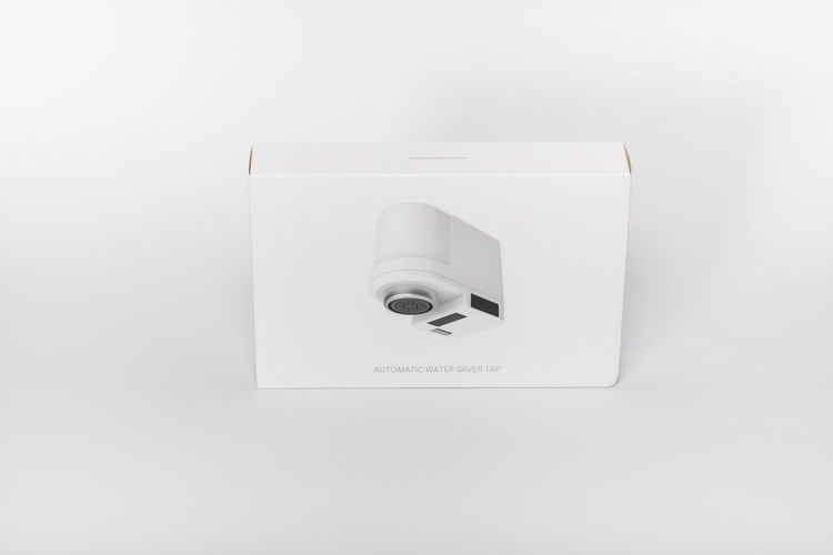 Directly above shot of telephone over white background
