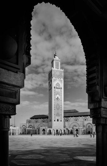 Low angle view of mosque hassan ii against sky