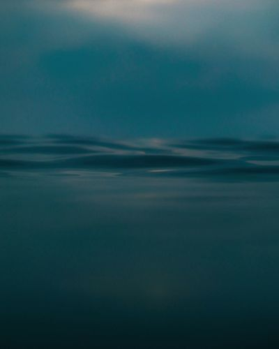 Water surface image of sea against sky