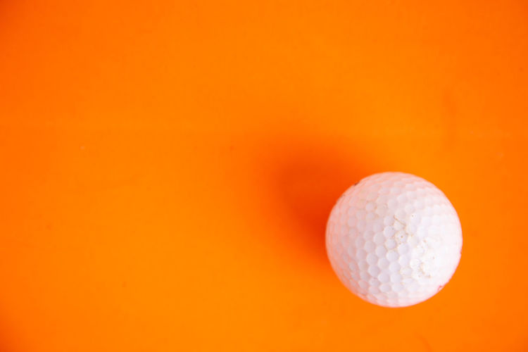 Backgrounds Ball Close-up Colored Background Copy Space Cut Out Food Food And Drink Freshness Golf Golf Ball Indoors  Japanese Food No People Orange Orange Background Orange Color Simplicity Single Object Sport Studio Shot White Color