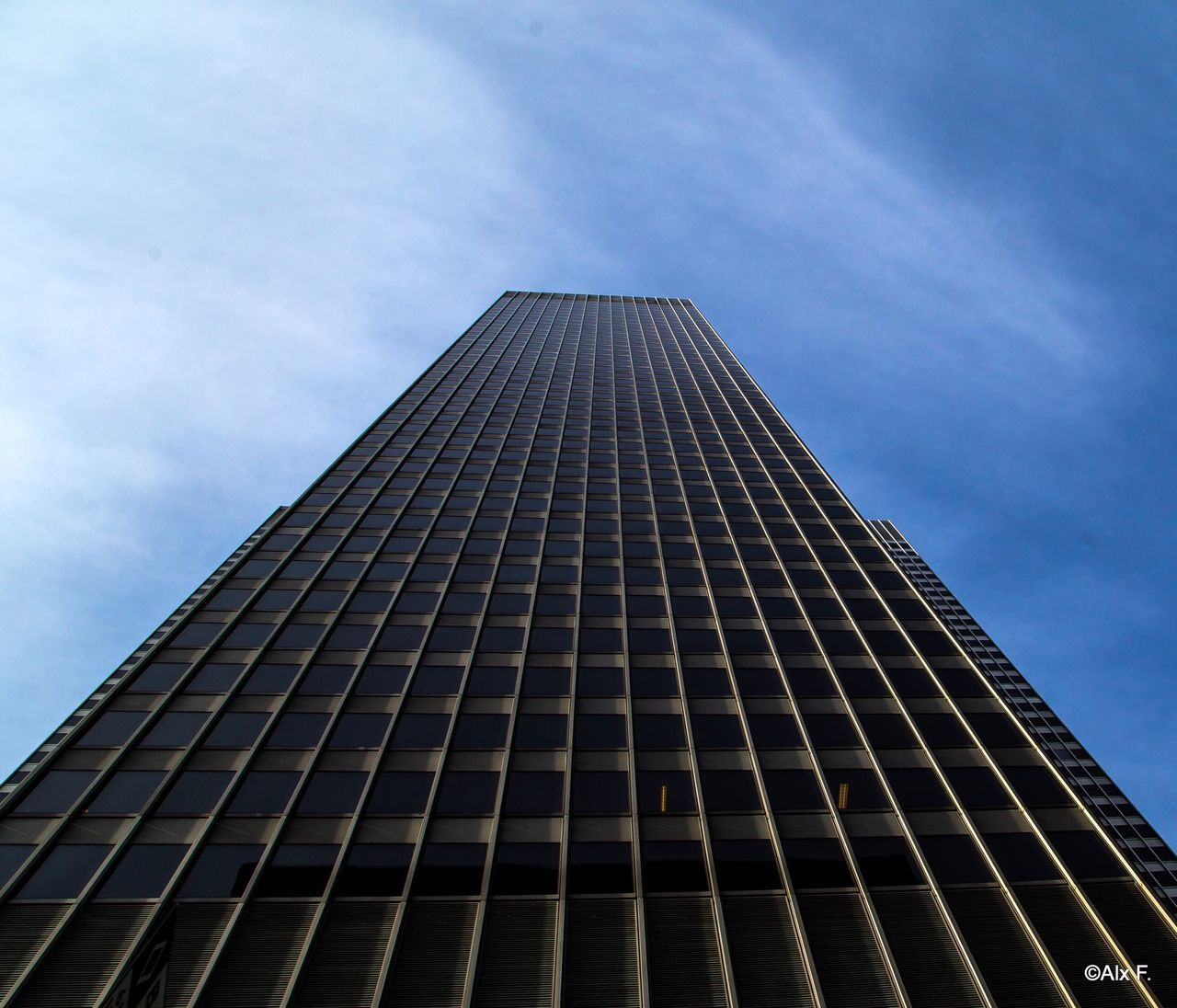 low angle view, architecture, modern, built structure, skyscraper, building exterior, sky, tall, no people, day, city, outdoors