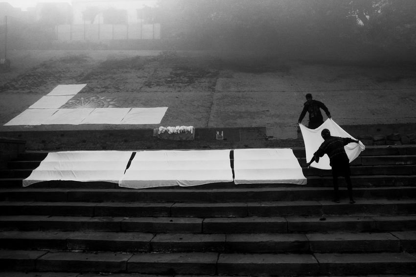 Curtain Raiser - While walking past the Ghats of Varanasi, came across this simple tradition of spreading clothes on the steps for drying. It was part of their daily routine. However, the winter foggy morning gave a different feel to this moment. I wasted no time and captured it Debarshi Mukherjee Photography Documentary Photography India Life Tradition Travel Winter Blackandwhite Daily Life Design Fog Lifestyles Men Outdoors People Steps And Staircases Street Photography Streetphotography Varanasi Varanasi Ghats EyeEmNewHere
