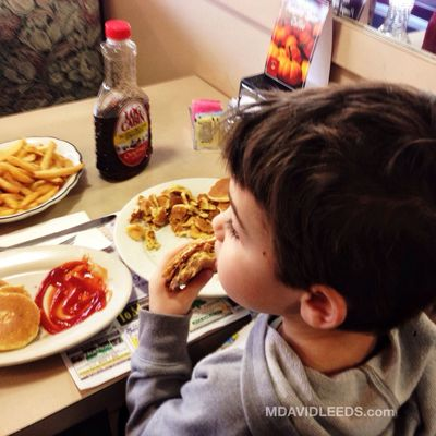 "Kid can eat. ""Ok. I will have a half of daddy's breakfast sandwitch, plus fries and ketchup, and a stack of silver dollar pancakes.. with syrup.. and some apple juice.. please."" Mdavidleeds Photos"