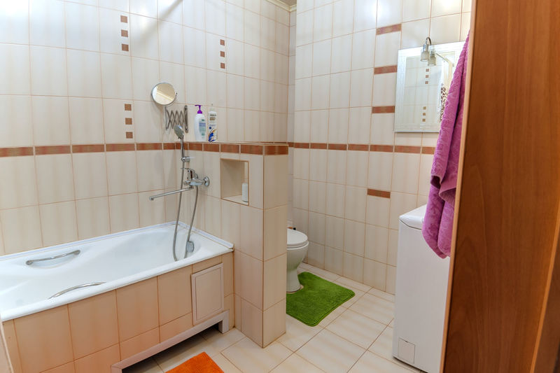 Bathroom Flooring Indoors  Tile Domestic Bathroom Domestic Room No People Hygiene Home Household Equipment Tiled Floor Wall - Building Feature Absence Pink Color Sink Mirror Home Interior Toilet Shower Hanging Clean