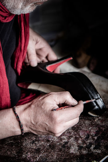 shoemaker of traditional tango shoes in Buenos Aires Handicraft Handmade Painting Shoemaker Shoemaking Tango Tango Shoes Trade Traditional