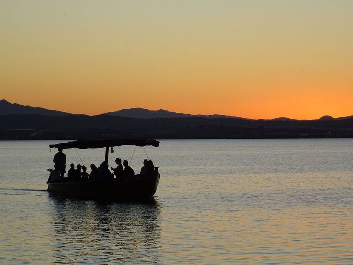 Silhouette Sunset Mountain Outdoors Lake Adults Only Adult Sky People Water Nature Only Men Day Boat Evening On The Lake