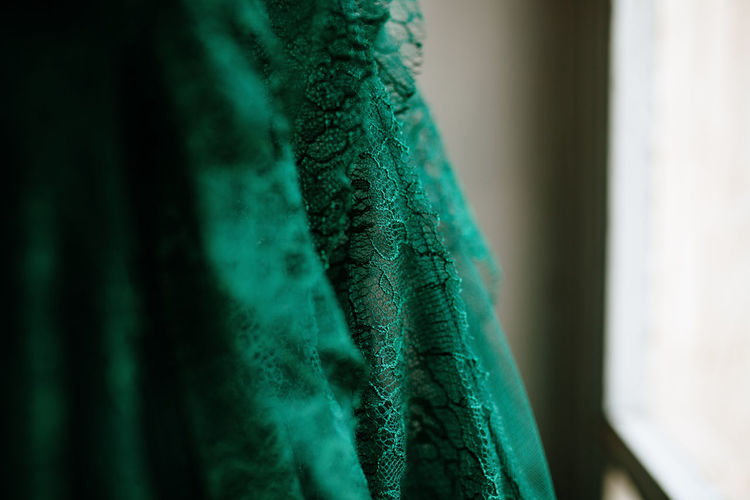 Green Color Green Dress Dressing Up Dresses Fabric Close-up No People Selective Focus Focus On Foreground Indoors  Still Life Day Textile Turquoise Colored Textured  Fragility Pattern Nature Vulnerability  Beauty In Nature Softness Feather  Woman Fashion Lifestyles Wedding Wedding Dress