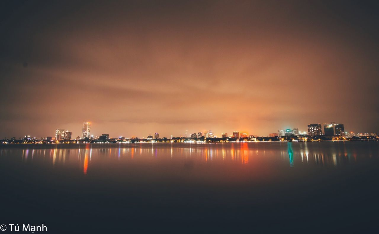 water, sky, reflection, waterfront, architecture, building exterior, built structure, city, illuminated, no people, building, nature, cloud - sky, night, scenics - nature, sea, sunset, outdoors, beauty in nature, cityscape, skyscraper, office building exterior