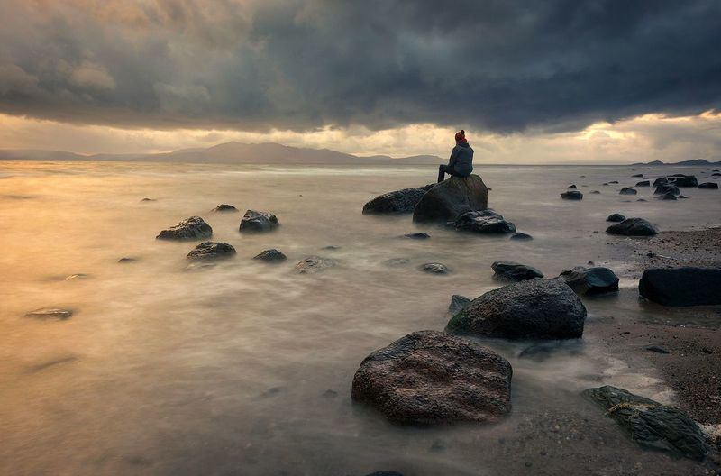 Hanging out with some rocks Sunset One Person Travel Destinations One Man Only Landscape EyeEm The Best Shots EyeEm Gallery EyeEmNewHere EyeEm Best Shots Scotland EyeEm Masterclass Landscape_Collection EyeEm Best Edits Dramatic Sky Seascape EyeEm Best Shots - Sunsets + Sunrise Horizon Over Water EyeEm Selects