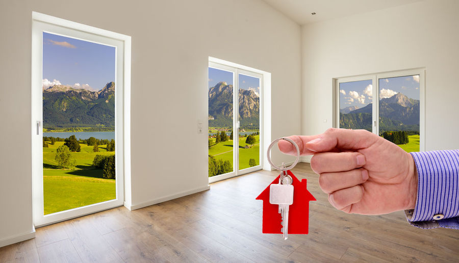 Man holding glass window at home