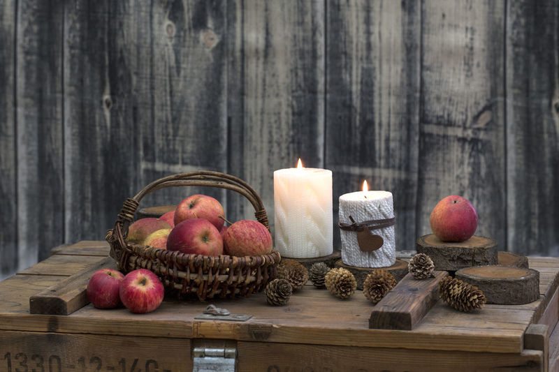 Decoration on old wooden crate with candles and apple Autumn Thanksgiving Winter Apple - Fruit Basket Candle Candlelight Country Life Crate Food Fruit Indoors  No People Red Apple Rural Scene Season  Still Life Wood - Material Wooden
