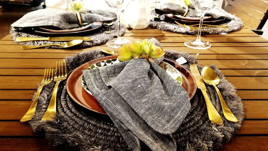 set to impress Plate Set Rustic Modern Home Interior Decoration Decor Table Prepared For The Meal Eat Place Mat Family Tradition Dinner Beautiful Napkin Interior Design Flower Table Wood - Material High Angle View Close-up Wooden Served Prepared Food Starter Ready-to-eat