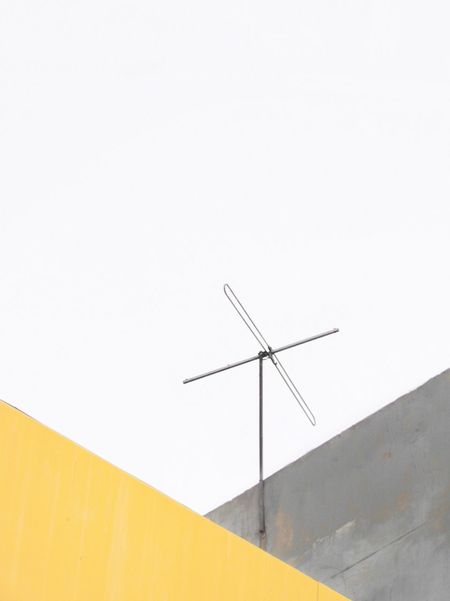 Lines And Shapes Straight Lines Antenna Yellow Minimalism Simplicity Urban Geometry Geometry Geometric Shape City Urban Landscape Urban Copy Space Low Angle View No People Clear Sky Architecture Day Outdoors White Background Building Exterior Close-up Creative Space
