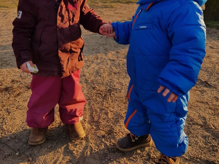 Holding hands Childhood Children Happy Outdoors Friends Playground Playing Fun Boy And Girl Kindergarten Sunshine Winter Warm Clothing Hands Holding Hands Love Cute Kids Toddler  Earth Mommylife Mother And Son Blue Red Shadows & Lights Growing Up