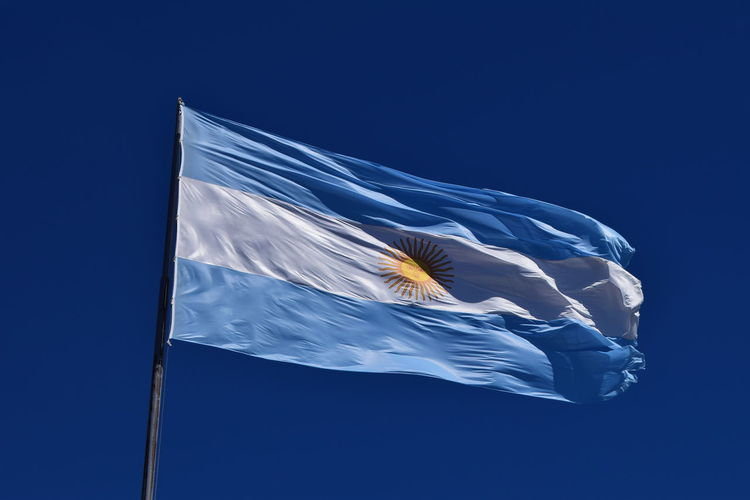Argentina Argentina Flag Blue Clear Sky Cold Temperature Copy Space Cultur Flag Identity Low Angle View Majestic National Flag Negative Space Outdoors Patriotism Pole Street Light Striped Weather Wind