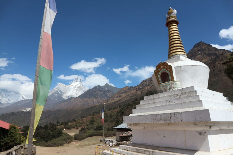 Stupa Beauty In Nature Blue Sky Day Dengboche Everest Mountain Nature Nepal No People Outdoors Place Of Worship Prayer Flags  Religion Sculpture Sky Spirituality Stupa The Architect - 2018 EyeEm Awards 10